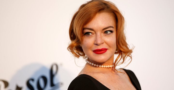 Lindsay Lohan Pokes Fun Of Her Criminal Past In This New Commercial [VIDEO]